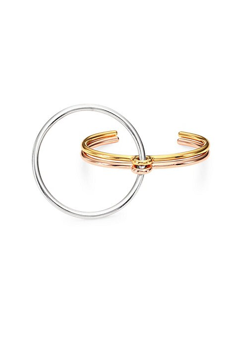 Image of From the Collection IV. Polished tri-tone bracelet with dramatic linked ring.18K goldplated and sterling silver. Slip-on style. Made in France.