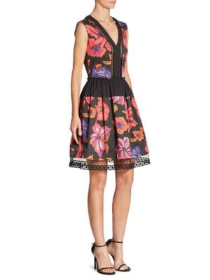 """Image of Lace trim details this vibrant floral printed cotton dress.V-neck. Sleeveless. Pullover style. Lined. About 38"""" from shoulder to hem. Cotton. Dry clean. Made in Italy. Model shown is 5'10"""" (177cm) wearing US size 4."""