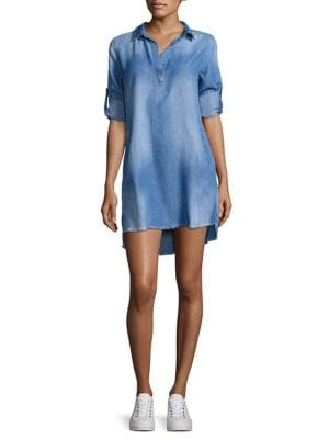 """Image of Cool split neck dress fashioned with frayed details. Spread collar. Roll tab sleeves. Front slash pockets. Hi-lo hem. Pullover style. About 35"""" from shoulder to hem. Tencel/lyocell. Machine wash. Imported. Model shown is 5'10"""" (177cm) wearing size Small."""