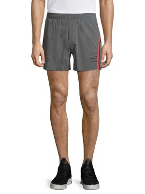 "Image of Sporty shorts made of flex light woven fabrication. Elasticized waistband. Side pockets. Back pocket. Inseam, about 7"".Polyester/spandex. Machine wash. Imported."