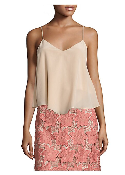 """Image of Smooth silk camisole with asymmetrical hem.V-neck. Sleeveless. Adjustable spaghetti straps. Asymmetrical hem. Lined. Pullover style. About 23"""" from shoulder to hem. Silk. Dry clean. Imported. Model shown is 5'10"""" (177cm) wearing US size Small."""