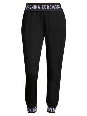 "Image of Cotton sweatpants with logo waist and cuffs. Elasticized waist. Side welt pockets. Rib-knit cuffs. Pull-on style. Rise, about 10"".Inseam, about 27"".Leg opening, about 10"".Cotton. Dry clean. Imported. Model shown is 5'10"" (177cm) wearing US size Small."