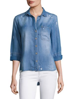 """Image of Easy, distressed chambray shirt with hi-lo hem. Spread collar. Three-quarter sleeves. Button front. Chest patch pocket. Hi-lo shirttail hem. Back yoke with inverted pleat. About 28"""" from shoulder to hem at longest point. Tencel. Machine wash. Imported. Mo"""