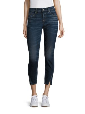 """Image of From the Essential Collection. Asymmetrical seams refresh classic skinny jeans. Belt loops. Zip fly with button closure. Five-pocket style. Vented hem. Rise, about 8.75"""".Inseam, about 27"""".Leg opening, about 10"""".Cotton/elastane. Machine wash. Made in USA o"""