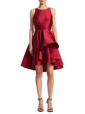 "Image of Flirty dress shaped by dramatic ruffle skirt. Boatneck. Sleeveless. Seamed waist. Ruffle skirt. Hi-lo hem. Concealed back zip closure. Lined. About 44"" from shoulder to hem at longest point. Polyester/silk. Dry clean. Imported. Model shown is 5'10"" (177cm"