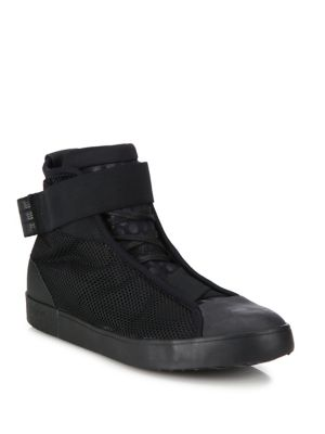 Image of Mesh-framed high-top sneaker with polka-dot tongue. Mesh and elastane upper. Round rubber cap toe. Pull-on style with grip-tape ankle strap. Mesh eyestay lining. Suede heel lining. Rubber sole. Imported.