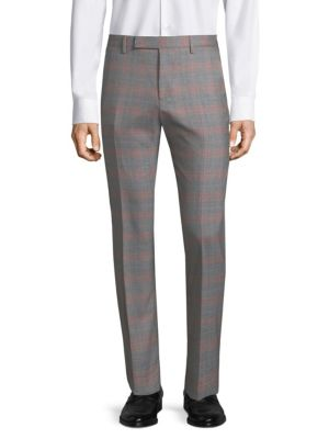 "Image of Slim tailored trousers in subtly checked wool. Belt loops. Zip fly with concealed hook-and-bar closure. On-seam pockets. Back welt pockets. Unfinished hems. Rise, about 10"".Inseam, about 36"".Wool. Dry clean. Made in Italy."