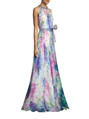"""Image of Floral silk organza gown with sparkling neckline. Embellished halterneck. Sleeveless. Concealed back zip. Self-tie waist. Flared skirt. Front keyhole cutout. Lined. About 62"""" from shoulder to hem. Silk. Dry clean. Imported. Model shown is 5'10"""" (177cm) we"""