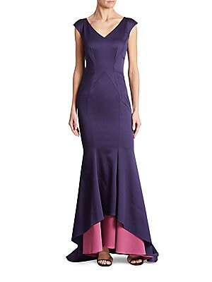 """Image of Two-tone mermaid skirt adorns this textured dress V-neckline Cap sleeves High-low hem Concealed back zip closure Back trail About 51"""" from shoulder to hem Acetate/polyester/polyurethane Dry clean Imported Model shown is 5'10"""" (177cm) wearing US size 4. Dr"""