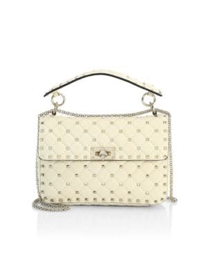 """Image of Rockstuds elevate elegant diamond-stitched leather bag. Top flat hande. Adjustable chain shoulder strap, about 23"""" drop. Turnlock flap closure. Goldtone hardware. One inside zip pocket. Leather lining.9""""W X 6""""H X 3""""D.Leather. Made in Italy."""