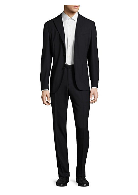 Image of A wardrobe essential, this solid suit is tailored from rich wool fabric in a fitted silhouette for a dapper look. Wool. Dry clean. Made in Italy. JACKET. Notch lapel. Front button closure. Long sleeves. Buttoned cuffs. Chest welt pocket. Waist patch pocke