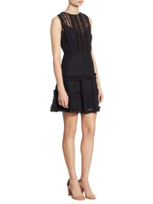 "Image of Rows of ruffles and ribbons define tiered dress. Crewneck. Sleeveless. Allover ribbon trim. Seamed waist. Sheer back. Concealed back zip. About 33"" from shoulder to hem. Polyester. Dry clean. Imported. Model shown is 5'10"" (177cm) wearing US size 4."