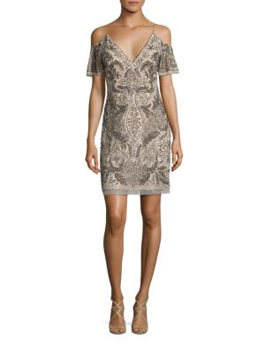 "Image of Glittery beads decorate this stunning cocktail dress. Deep V-neck. Spaghetti straps. Cold-shoulder cutouts. Ruffled short sleeves. Concealed back zip. Sheer hem. Lined. Polyester. Dry clean. Imported. Model shown is 5'10"" (177cm) wearing US size 4."