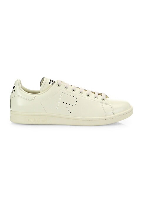 Image of Shiny leather low-top sneakers with perforated initial. Leather upper. Lace-up style. Rubber sole. Imported.