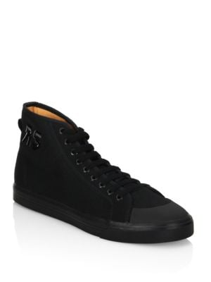 Image of From the Raf Simons. Sleek high top sneakers crafted from canvas. Canvas upper. Round-toe. Lace-up closure. Canvas lining. Rubber sole. Imported.