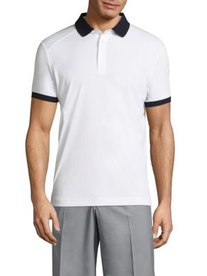"Image of Stretchable polo rendered with UV protection UPF 50+.Polo collar. Front button placket. Short sleeves. Bride embroidery at chest and left arm. About 26"" from shoulder to hem. Polyester. Machine wash. Imported."