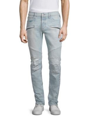 """Image of Skinny fit jean with moto detail at knee and destruction. Rise, about 10"""".Leg opening, about 13"""".Inseam, about 34"""".Cotton/polyester/elastane. Machine wash. Imported."""