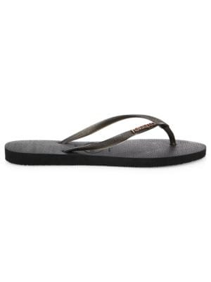 Image of Rubber thong flip-flops featuring metallic straps. Rubber upper. Open toe. PVC sole. Imported.