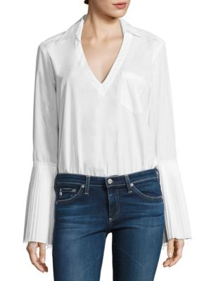 """Image of Edgy shirt bodysuit in a practical design. Shirt collar. Bell sleeves with pleated cuffs. Front patch pocket. Snap closure at base. About 26"""" from shoulder to hem. Cotton/polyamide/elastane. Dry clean. Made in USA."""