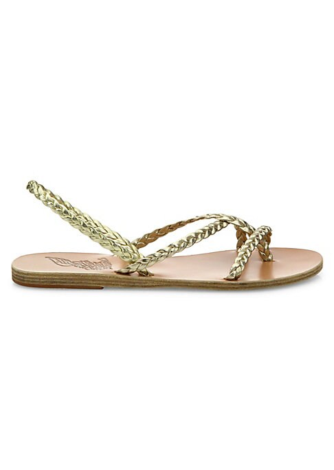 Image of Glossy braided straps on stacked flat sandals. Vachetta leather upper. Slip-on style. Vachetta leather lining. Leather/rubber sole. Made in Greece.