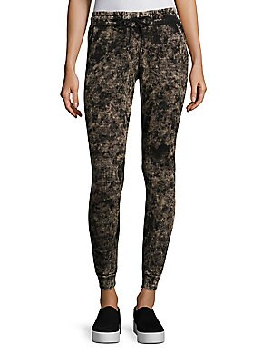 """Image of Comfy joggers with distinctive textured pattern Elasticized waistband with drawstrings Side slash pockets Ankle cuffs Rise, about 9"""" Inseam, about 30"""" Cotton Machine wash Made in USA Model shown is 5'10"""" (177cm) wearing US size Small. Contemporary Sp - Ca"""