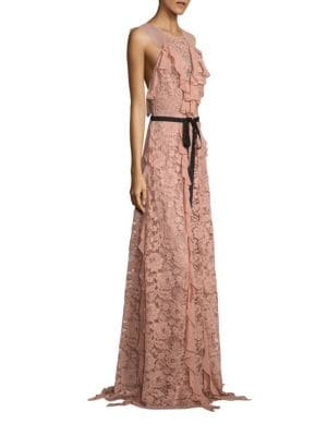 "Image of Cascading ruffles elevate lace open-back gown. Roundneck. Sleeveless. Allover ruffles. Self-tie grosgrain waist. Open back. Concealed back zip. About 62"" from shoulder to hem. Polyester. Dry clean. Imported. Model shown is 5'10"" (177cm) wearing US size 4."
