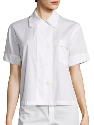 """Image of Intricate chiffon piping complements this silk top. Peter Pan collar. Short sleeves. Mother-of-pearl button front. Chest patch pocket. About 22"""" from shoulder to hem. Silk. Machine wash. Made in USA."""