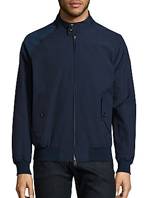 "Image of Water-resistant jacket designed with Coolmax technology Stand collar with button closure Front zip closure Long raglan sleeves with ribbed cuffs Waist buttoned flap pockets Ribbed hem About 32"" from shoulder to hem Lined Cotton/polyester Dry clean Made in"