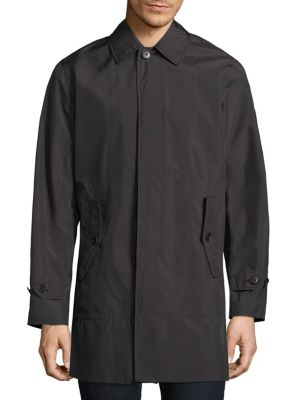 """Image of Modern water-resistant jacket with Baratex construction. Point collar. Long sleeves. Button-tab cuffs. Concealed button front. Waist buttoned flap pockets. Back storm vent. About 36"""" from shoulder to hem. Polyester. Machine wash. Imported."""