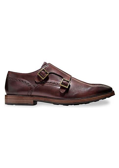 Image of Buckle oxfords with minimalist brogue detail. Stacked heel. Leather upper. Leather trim. Almond toe. Monk strap closure. Leather lining. Rubber sole. Imported.