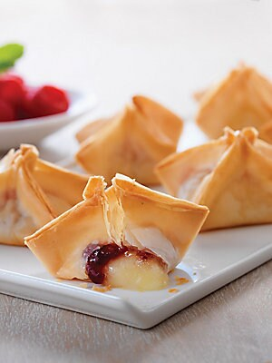Image of Phyllo dough stars filled with creamy brie and raspberry preserves. Includes: 18 stars Frozen, ready to bake 7 oz Shelf life: 3-6 months frozen Imported SPECIAL PROCESSING & DELIVERY This item ships from vendor and requires 2-3 business days of vendor pro
