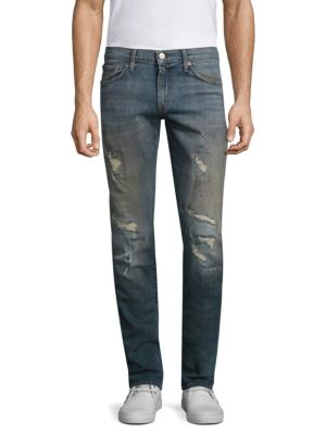 "Image of On-trend distressed jeans in a slim-fitting silhouette. Belt loops. Zip fly with button closure. Five-pocket style. Rise, about 10"".Inseam, about 31"".Cotton/polyurethane. Dry clean. Imported."