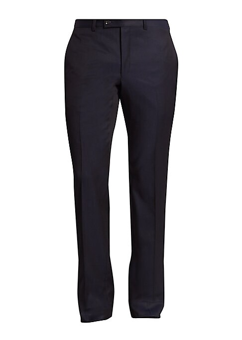"Image of EXCLUSIVELY OURS. Regular solid pants tailored from a luxe fabric. Flat-front style. Belt loops. Zip-fly with button-tab closure. Slash pockets. Back buttoned welt pockets. Inseam, about 34"".Wool. Dry clean. Made in Canada."