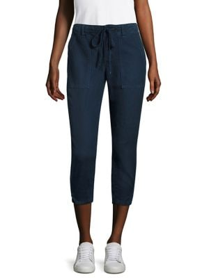 """Image of Impeccably tailored pants updated with patch pockets. Drawstring waist. Belt loops. Button fly. Slash patch pockets. Side slit hem. Rise, about 10"""".Inseam, about 25"""".Leg opening, about 11"""".Linen/cotton. Machine wash. Made in United States. Model shown is"""
