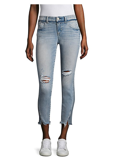 """Image of Cool cropped skinny jeans feature distressed details. Belt loops. Zip fly with button closure. Five-pocket style. Frayed slit hem. Rise, about 9"""".Inseam, about 27"""".Leg opening, about 10"""".Cotton/elastane. Machine wash. Made in United States. Model shown is"""