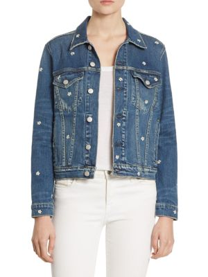 """Image of Mini embroidered blooms update denim jacket. Point collar. Long sleeves. Button cuffs. Button front. Allover floral embroidery. Chest button-flap patch pockets. Waist slash pockets. Button tabs at back hem. About 22"""" from shoulder to hem. Cotton. Machine"""