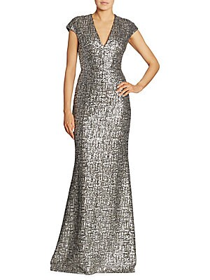 "Image of Cap sleeve gown in a radiant sequin embellished pattern V-neck Cap sleeves Concealed back zip Silk lining About 63"" from shoulder to hem Polyester Dry clean Imported Model shown is 5'10"" (177cm) wearing US size 4. Designer Evenin - Classic Evening. Carmen"