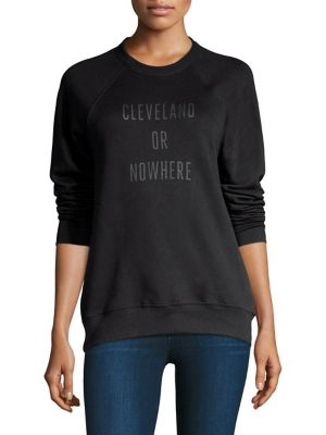 """Image of Raglan sleeves sweatshirt with front Cleveland graphic. Roundneck. Long raglan sleeves. Pullover style. About 26"""" from shoulder to hem. Polyester. Machine wash. Imported. Model shown is 5'10"""" (177cm) wearing size small."""