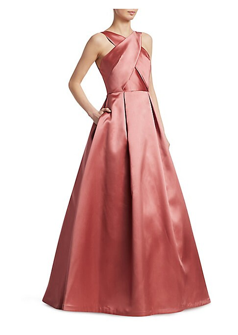 "Image of Elegant ball gown topped with crossover neckline. Crossover halterneck. Sleeveless. Seamed waist. Full skirt. Concealed back zip. Lined. About 62"" from shoulder to hem. Polyester. Dry clean. Imported. Model shown is 5'10"" (177cm) wearing US size Small."