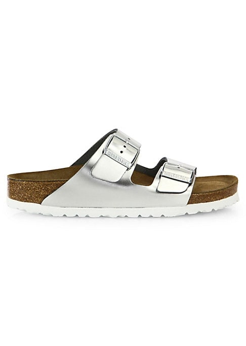 Birkenstock\'s contoured cork footbed supports the arches of your foot, and cradles your heel for all day comfort. Stylish metallic slides features anatomically shaped soft foot-bed. Leather upper Rounded toe Slip-on style Anatomically shaped cork-latex footbed Suede lining Anatomically shaped cork-latex insole EVA sole Imported. Women\'s Shoes - Contemporary Shoes > Saks Fifth Avenue > Barneys. Birkenstock. Color: Metallic Silver. Size: 39 (8).
