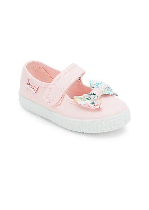 Image of Vibrant floral bow complements this comfy silhouette. Adjustable grip tap strap. Canvas upper. Canvas lining. Rubber sole. Made in Spain.