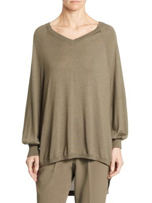 "Image of .On-Trend hi-lo silhoutte pullover.V-neck. Long sleeves. Hi-lo hem. Pullover style. About 25"" from shoulder to hem. Cashmere/silk/polyamide/polyester. Dry clean. Made in Italy. Model shown is 5'10"" (177cm) wearing size Small."