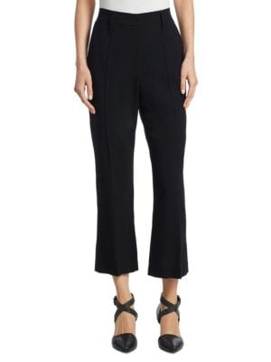 """Image of Pleated wool pants in ankle length design. Belt loops. Zip fly with hook-and-eye closure. Front seam pockets. Back welt pockets. Rise, about 10"""".Inseam, about 28"""".Wool. Dry clean. Made in Italy. Model shown is 5'10"""" (177cm) and wearing US size 4."""