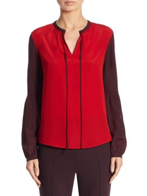 "Image of Colorblock silk blouse with split tie neckline. Split neck with drawstring. Long sleeves. Buttoned cuffs. About 25"" from shoulder to hem. Silk. Dry clean. Imported. Model shown is 5'10"" (177cm) wearing US size 4."