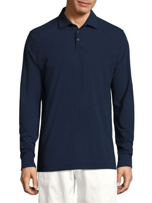 Image of Sophisticated solid polo featuring side slits. Polo collar. Front three-button placket. Long sleeves with buttoned cuffs. Cotton. Hand wash. Imported.