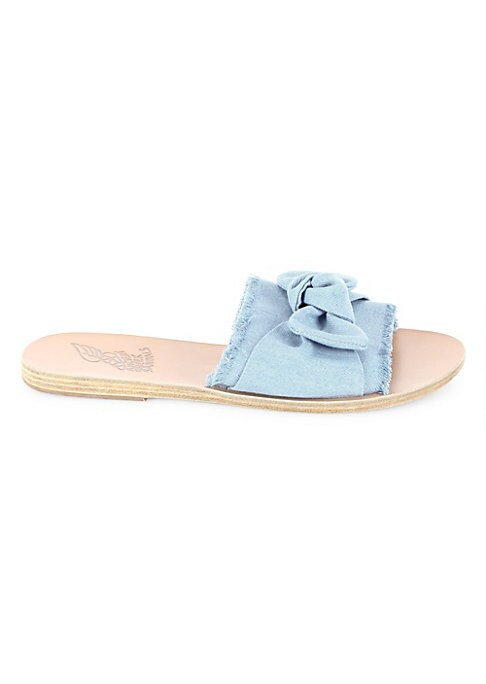Image of Comfy leather sandals featuring a creative bow tie accent. Fabric upper. Slide-on style. Leather lining. Leather /rubber sole. Imported.