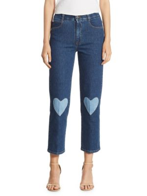 """Image of High-rise straight jean with whimsical heart patches. Belt loops. Zip fly with button closure. Five-pocket style. Rise, about 10"""".Inseam, about 26"""".Leg opening, about 12"""".Cotton/elastane/polyurethane. Dry clean. Made in Italy. Model shown is 5'10"""" (177cm)"""