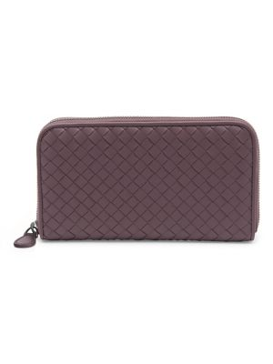"""Image of .Woven. Intrecciato. nappa. leather zip wallet with slender lines and a sheer nappa interior. Zip-around closure. Gunmetal-tone hardware. Eight inside credit card slots. Four inside bill compartments. One inside zip pocket. Leather lining.7.5""""W x 4""""H x 1"""""""