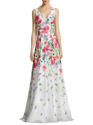 "Image of Chiffon A-line gown in painterly floral print.V-neck and back. Sleeveless. Seamed waist. Flared skirt. Concealed back zip. Lined. About 61"" from shoulder to hem. Polyester. Dry clean. Imported. Model shown is 5'10"" (177cm) wearing US size 4."