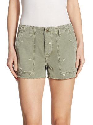 """Image of Floral embroidered shorts updated with frayed hem. Belt loops. Zip fly with button closure. Side patch pockets. Back button flap pockets. Rise, about 10"""".Inseam, about 3"""".Cotton. Machine wash. Made in USA of imported fabric. Model shown is 5'10"""" (177cm) w"""